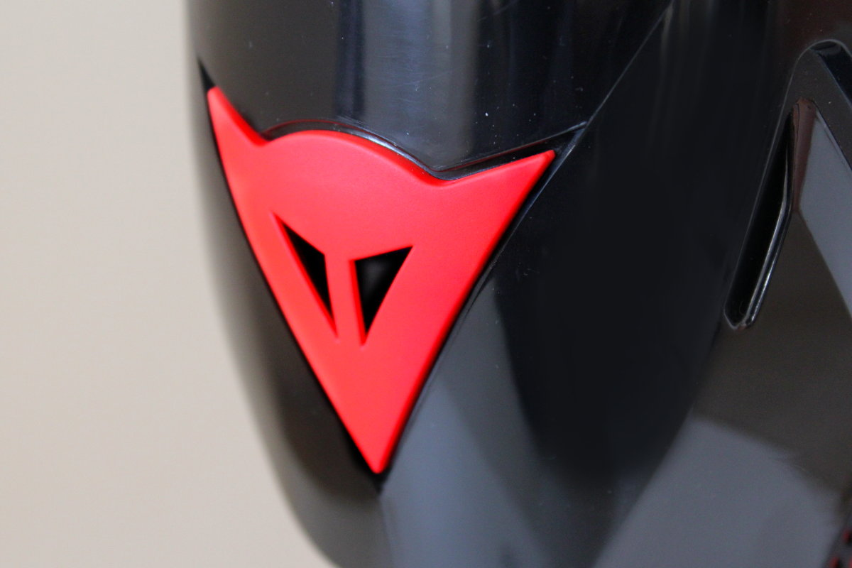 logo dainese botas moto
